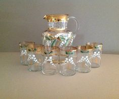 Gorgeous Victorian 19th century glass water pitcher and six matching glass tumblers... Romanticism at its finest! This seven piece serving set is made of delicate clear glass; and has been finely hand painted in Victorian Bohemian art designs and Lilly of the Valley flowers. #SophiasWonderland #Victorian