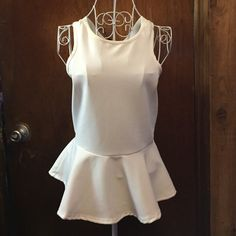 Windsor ivory top! Ivory crisscross peplum top! New with tags! Does have small makeup stains on the inside collar & small outside. Only tried on, nothing too big. WINDSOR Tops