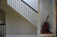 Adding Third Floor to Your House for Extra Space and Room: Traditional Staircase Decor With Accustic Guitar At Home With Third Floor Addition ~ warnhouse.com Decoration Inspiration