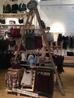 Brandy Melville interior store layout- use of large pyramid made out of wood- very simple to make merchandise show more. Solely used as a prop to hold merchandise. Lack many vibrant colors. The experience they're trying to convey to customers could be that they want their customers to wear comfy basics. Merchandise seems somewhat unplanned- the story their trying to tell is a little unclear.