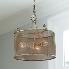 Get the rustic-chic look with our Geneva Pendant.  Fine mesh drum shade encircles three bulbs, softly filtering the light.  Antiqued metal details and a heavil…