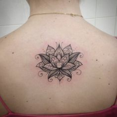 Small upper back tattoo of a lotus flower, by Ivy... - Small Tattoos for Men and Women