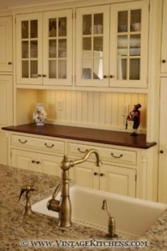 Like the beige cabinets with the chocolate brown wood counter top