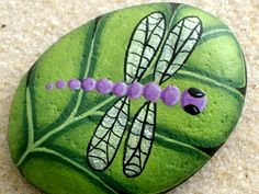 Made to order! Silver wing lavender purple dragonfly has landed on a brilliant chartreuse green leaf. Keep those napkins from flying off the picnic table with this colorful woodland table paperweight! Leaf measures approx. 2-1/4 long x 1-1/2 wide x 1/2 thick and will ship First Class Mail in a padded envelope accompanied by a short biography about the artist and care instructions for your work of art. Stone leaf was painted with outdoor paints making it perfect for outdoor placement. This…