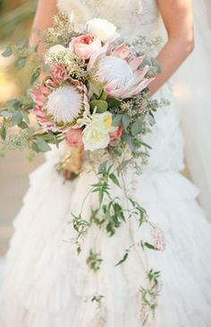 ranunculus, clusters of seeded eucalyptus and cascading greens to create a pretty boho bouquet by Floral Theory and Joielala Photographie | Feathers are…