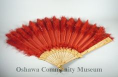 Ladies Red Fan, red tulle with red feathers at ends of ribs.