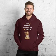 A new hoodie for Yorkshire Terrier dad parent and Yorkie friends from our new collection, Almost normal, with white print paws on the left sleeve. #yorkie #yorkshireterrier #yorkieclothes #yorkielover #yorkiehoodie #hoodie #doghoodie