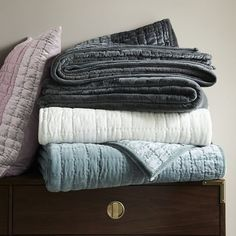 For a cozy winter bed, add a luxe layer of quilted velvet in dusty, muted tones. (Starting at $100, West Elm)