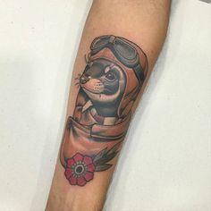 Neotraditional style mustela putorius aviator tattoo.