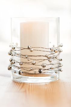 Our mercury glass garland features antiqued silver beads on a twisted, rustic wire strand that is generously sized at 24 feet long. Easy to bend and approximately 2 inches between each bead. Makes stunning centerpieces, tiaras, napkin rings, wreaths and much more. Versatile and reusable.