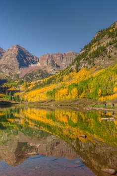 Maroon Peak and North Maroon Peak,Located just 10 miles west ofAspenor 16 fromSnowmassup Maroon Creek Road off Hwy. 82 in a glacial valley,the Rocky Mountains. Hiking trails provide access to theWhite River National Forest.