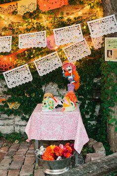 papel picado photo booth prop station // photo by Kate Romenesko // http://ruffledblog.com/chicago-day-dead-wedding
