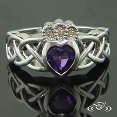 Hearts will glow with this #claddagh ring featuring a lovely violet gem. #GreenLakeJewelry #Cetic