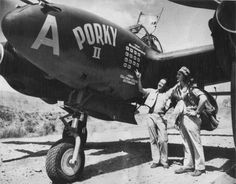 """25 year old Major Ed """"Porky"""" Cragg CO of the 80th Fighter Squadron, 8th Fighter Group poses with his crew chief and their P-38H Lightning """"Porky II"""" after he scored his 14th victory over Wewak on 22 December 1943. Major Cragg scored 7 of his victories in this aircraft. He had less than four days to live when this photo was taken. On Boxing Day 1943 Porky was shot down while covering the Cape Glouster landings."""