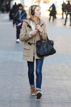 With cuffed jeans, brown boots and black bag - Styleoholic