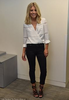 Call-centre chic: Mollie King was simply stylish in a white shirt and black skinny jeans