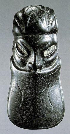 An Olmec 'duck bill' pendant