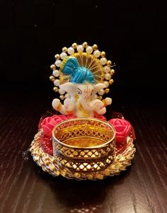 This listing is for one ganesh diya holder. The diya holder is not attached but can be. Comes with double sided tape. Comes packed in a box. Diwali Diy, Diwali Craft, Indian Wedding Favors, Wedding Favours, Diwali Decorations, Festival Decorations, Crystal Beads, Crystal Rhinestone, Handmade Decorative Items
