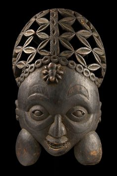 Africa   Mask of a dignitary from the Grassfields of Cameroon   Wood    The spider motif is widely spread in the Cameroon Grassfields. The spider is a symbol for wisdom and plays an important role in truth telling.