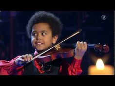 AMAZING CHILD VIOLIN PRODIGY: Akim Camara began playing violin at the age of two. His talent was quickly noticed by legendary violinist Andre Rieu and now he's a world-famous child soloist. Here he is playing Ave Maria in 2009.