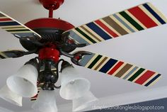Great idea to update old fans. Paint stripes or modge podge fabric on blades.