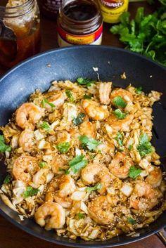 Spicy Shrimp and Cabbage Stir Fry 1 pound large or jumbo shrimp, uncooked 1/2 head of cabbage, shredded (or ~12 oz bag pre-shredded cabbage) 2 tbsp low sodium soy sauce 1 tbsp hoisin sauce 1 tbsp rice vinegar 1/2 tbsp sriracha (or more to taste) 1 tsp honey 1/2 tsp ground ginger 1/4 tsp garlic powder 1 tsp sesame oil 1-2 tsp toasted sesame seeds, for garnish 1 tbsp chopped cilantro, for garnish 1. Preheat nonstick skillet (or wok) over medium high heat. Toss shrimp with 1-2 tbsp sauce. Add…