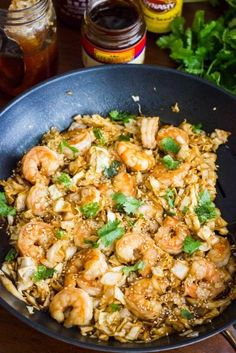 Spicy Shrimp and Cabbage Stir Fry 1 pound large or jumbo shrimp, uncooked 1/2 head of cabbage, shredded (or ~12 oz bag pre-shredded cabbage) 2 tbsp low sodium soy sauce 1 tbsp hoisin sauce 1 tbsp rice vinegar 1/2 tbsp sriracha (or more to taste) 1 tsp honey 1/2 tsp ground ginger 1/4 tsp garlic powder 1 tsp sesame oil 1-2 tsp toasted sesame seeds, for garnish 1 tbsp chopped cilantro, for garnish  1. Preheat nonstick skillet (or wok) over medium high heat. Toss shrimp with 1-2 tbsp sauce. Add…