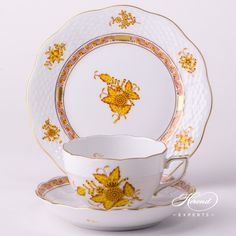 An Apponyi orange tea cup 3 dl - Herend Vintage fine china. Traditional European minimalism.