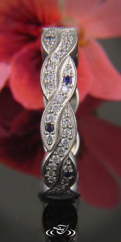 Weave style ring with diamonds and sapphires