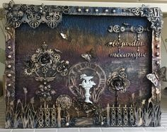 Le jardin mecanique is a large Steampunk themed mixed media canvas