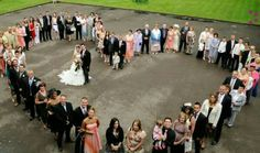 Wouldn't that be amazing to get a group shot of all the guests as the heart surrounding the bride and groom
