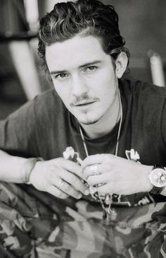 Orlando Bloom, male actor, celeb, intense eyes, hottie, eyecandy, hands, portrait, photo b/w.