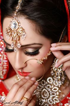 Indian Bridal Makeup....uhhhh....the nose ring is cool but a little big....don't ya think?