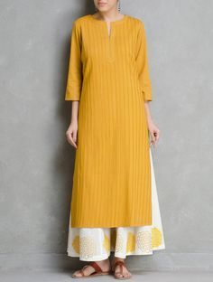 Buy Mustard Pintuck Cotton Kurta by Ruh Apparel Tunics & Kurtas Relaxed… Pakistani Dresses, Indian Dresses, Indian Outfits, Mode Abaya, Mode Hijab, Indian Attire, Indian Ethnic Wear, Kurta Designs Women, Blouse Designs