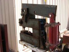 """Hydraulic Punch Homemade hydraulic punch featuring a 15-ton capacity and a 12"""" throat. Frame fabricated from 1/2"""" x 5"""" flat plate stacked in 3 layers."""