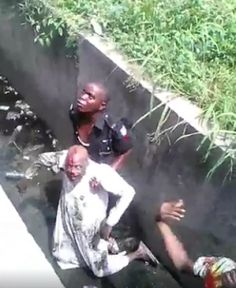 Residents manhandle policeman for pushing man into gutter{VIDEO}   Some residents of Oshodi Lagos State on Friday attacked two policemen who pushed a man into a gutter while trying to arrest a commercial bus driver in the area. The incident happened at airport bus stop at about 12pm. The policemen reportedly came in a wagon. In a viral video an irate mob in the area apprehended the policemen but one escaped by the whiskers. They asked the apprehended police officer to go into the gutter and…