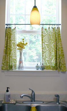 kitchen curtains @ Pin Your Home  Very slick - paisley, the dowel rod, the rings, the color