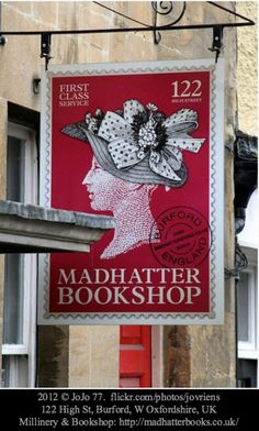Madhatter Bookshop 2012 © JoJo 77 (Photographer) via flickr.   Millinery & Book Shop: http://madhatterbooks.co.uk  Located in the pretty medieval town of  Burford on the River Windrush in the Cotswold hills, west Oxfordshire, England. [Do not remove caption. I love old stamps and this sign is priceless!  The law requires you to credit the copyright holder. List/Link directly to the photographer's website.]