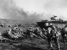 Men of US Marines, Second Battalion, Seventh Regiment waited to move inland on Iwo Jima, soon after going ashore, 19 Feb 1945 Iwo Jima Memorial, Battle Of Iwo Jima, Man Of War, Story Of The World, Us Marines, Marine Corps, Usmc, World War Two, Wwii