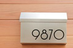 Modern House Numbers and mailbox... http://www.modernhousenumbers.com/