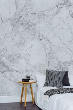 This marble wallpaper design leaves your interiors looking sleek and sophisticated. Perfect for a minimal look bedroom.