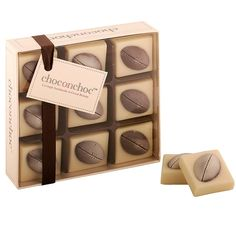 White and Dark Belgian Chocolate Rugby Balls. White and Dark Belgian Chocolate Rugby BallsDefinitely chocolates for a rugby fan!This is a box of delicious white