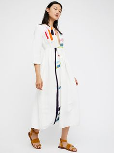 Embroidered Midi Dress | Linen midi dress featuring beautiful and bright embroidery with a structured center cutout. Elegant and femme.    * Lined * Quarter-length sleeves