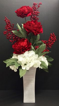 Winter 2014 Season faux floral: Red Peonies, white Hydrangeas, berry picks on glitter silver tall urn vase. Original design and arrangement by http://nfmdesign.synthasite.com/:
