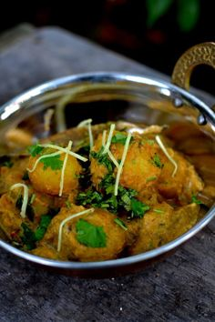 Dum Aloo: A rich, fragrant curry of baby potatoes simmered in a gently spiced yogurt gravy. Perfect with flatbreads or rice.