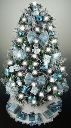 Unique Blue and silver Christmas Tree Decor Ideas. A beautiful Christmas tree can awaken the Christmas spirit of everyone who sees it. Make sure your Christmas tree looks charming and classic with … Blue Christmas Tree Decorations, Tabletop Christmas Tree, Silver Christmas Tree, Beautiful Christmas Trees, Noel Christmas, Holiday Tree, Xmas Tree, Turquoise Christmas, Magical Christmas