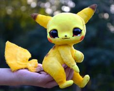 If you're not already satisfied with the cuteness level of regular Pokemon plushies, check out these custom made dolls! These one of a kind Pokemon dolls are completely handmade with glass eyes, high quality faux fur and a fully posable wire skeleton. Pikachu, Baby Animals, Cute Animals, Pokemon Dolls, Plushies, Etsy, Art Dolls, Creations, Monsters
