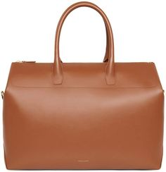 Italian calf leather saddle travel bag with saddle matte patent interior. Vegetable tanned leather top handle, interior side pocket and zip closure. Mansur Gavriel Bag, Summer Essentials, Vegetable Tanned Leather, Travel Bag, Tan Leather, Calves, Purses And Bags, Shoulder Strap, Mini