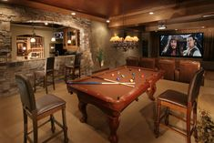"My dream living space."" I would replace the pool table with my dining room table (which would go really great with the rustic room) and where the ""media"" area is, there would still be a tv only not quite so big, with family pics on the walls and some really comfy seating."
