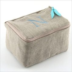 Our signature personalized linen jewelry case is perfect for travel or jewelry storage at home. #MadeInTheUSA We have lined it in cotton quilt fabric to keep your treasures protected and secure. Our case is generously sized for large jewelry pieces and accented with a satin ribbon zipper pull. Personalization is complementary.